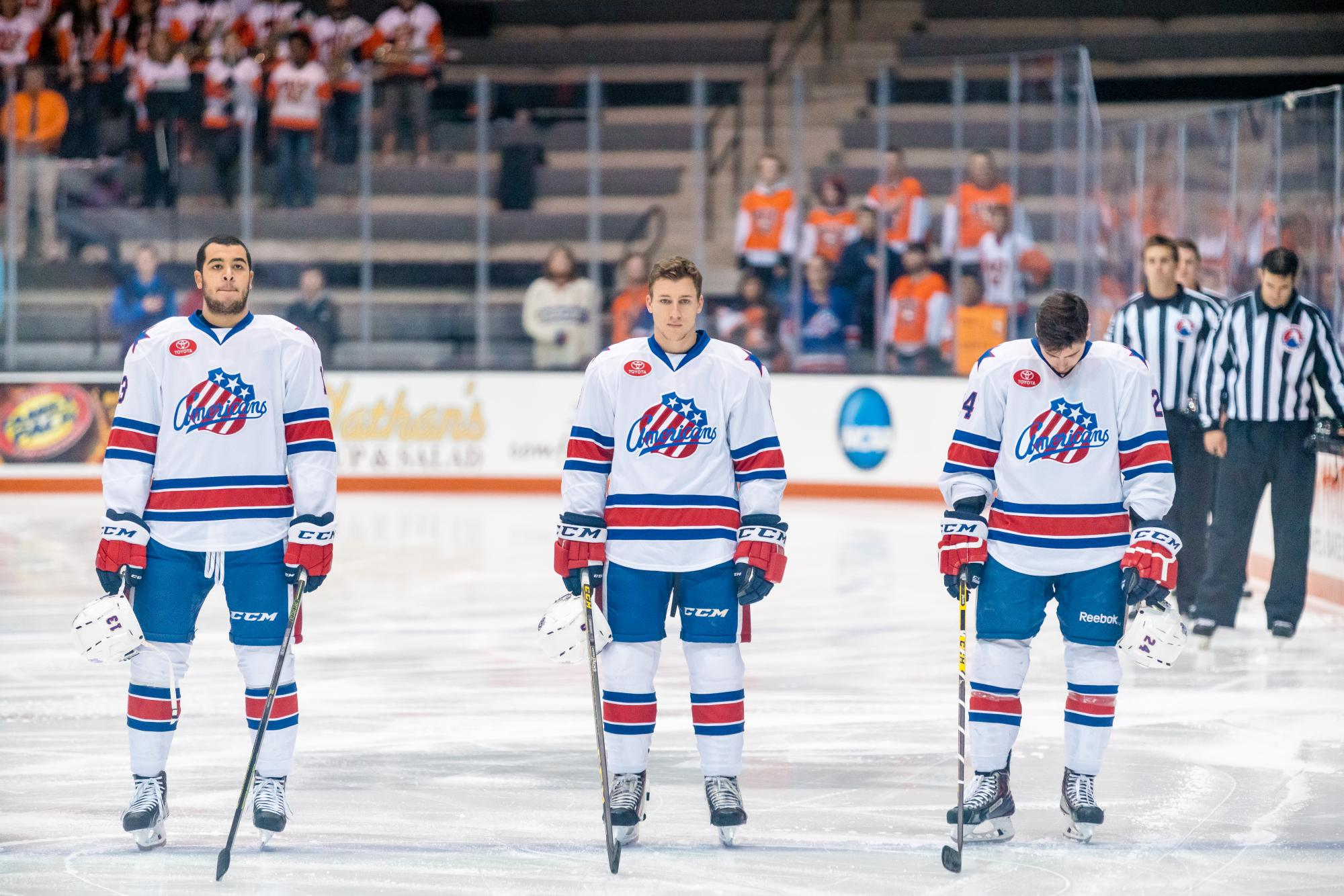 Matt Garbowsky (center) stands on the ice during the National Anthem at the Rochester Americans game at the Gene Polisseni Center on Oct. 11 2015. Photograph by Rob Rauchwerger.