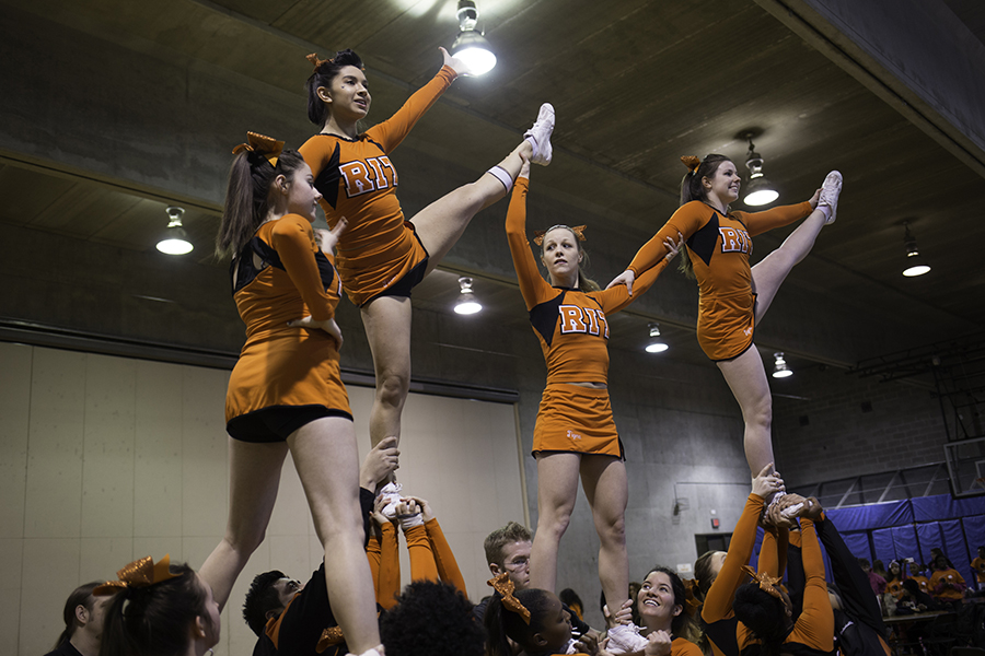The RIT cheerleading team practices before the basketball game at the Rochester Institute of Technology in Rochester, N.Y. on Feb. 12, 2016. Photograph by Joseph Ressler.