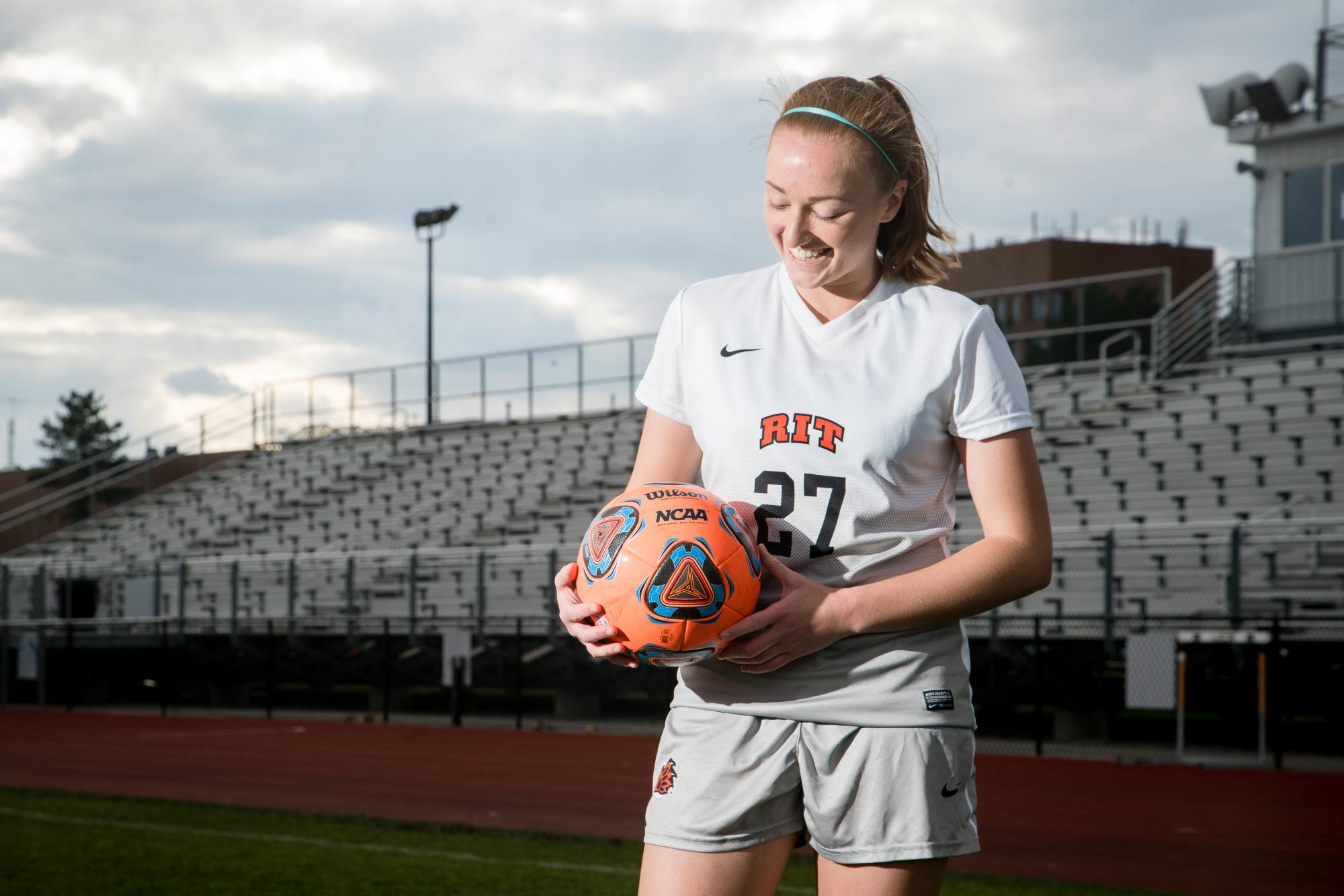 Natalie Hurd poses for portrait on RIT's soccer field. Photograph by Rob Rauchwerger.