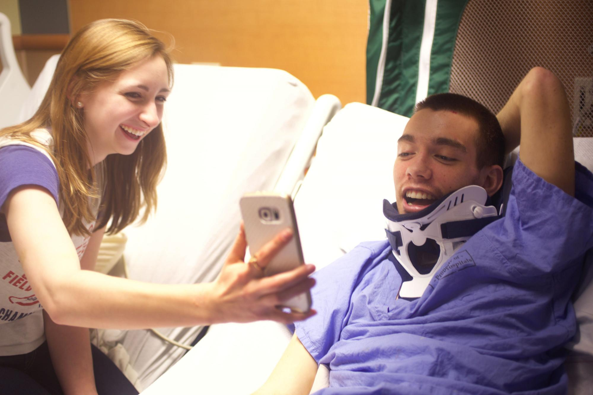 Marisa Langlois, a friend of Chris', holds the phone so Chris can video chat with his family on Mar 3, 2016. Chris's mother, Sarah Clemens, set up a video chat with her family so that they could see and talk to Chris every evening.  Photography by Dominique Hessert.