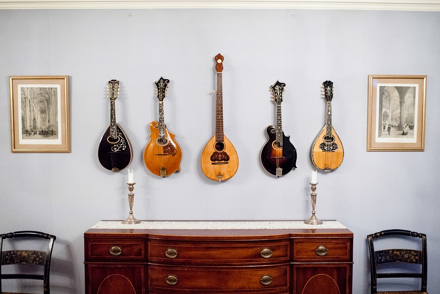 Some of RIT President Bill Destler's Mandolin and Banjo collection in the formal dining room at his home, Liberty Hill. Photo: William J. Ignalls