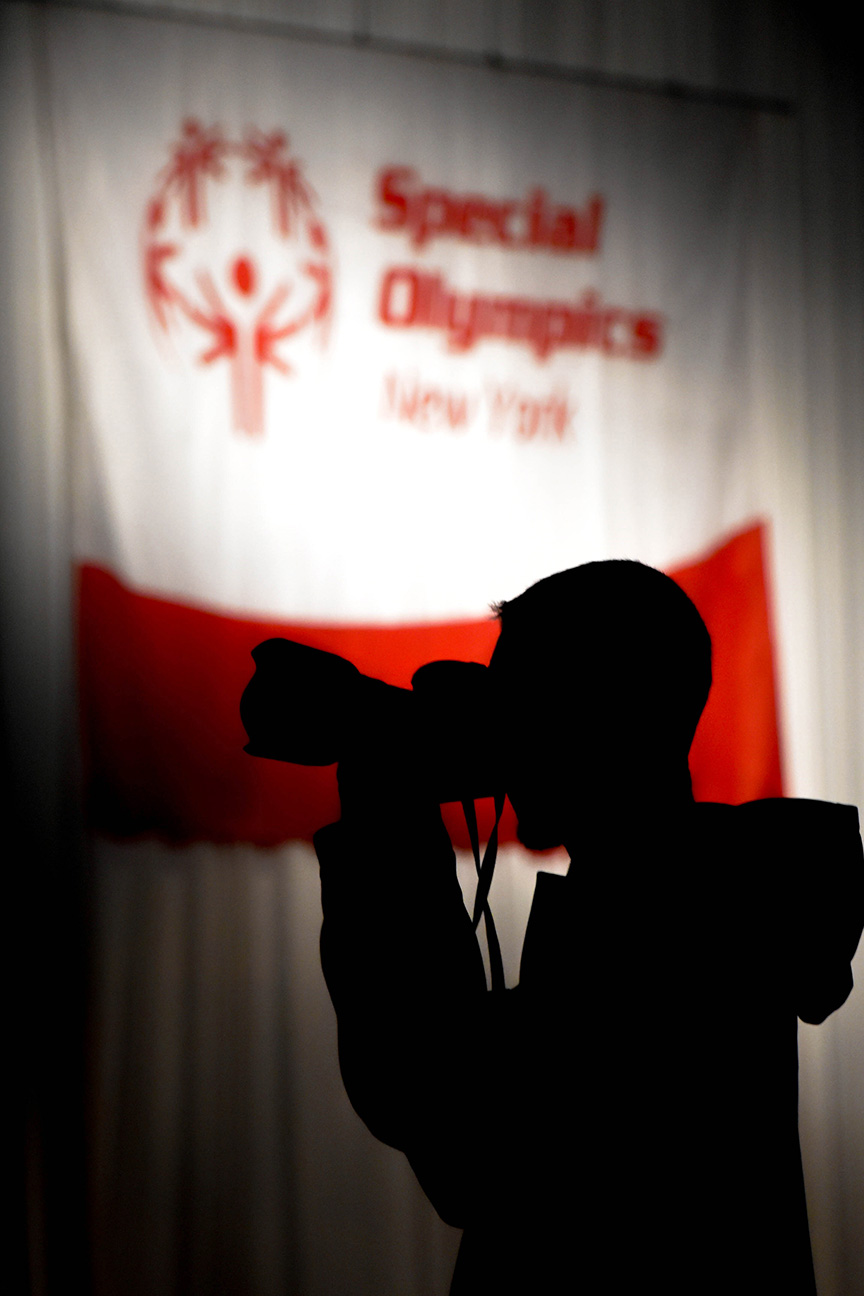 Coburn Swem, a fourth year photojournalism major, frames a shot before the start of the opening ceremony at the Riverside Convention Center in Rochester, N.Y. on Feb. 22, 2019.  Photo by Tony Wen