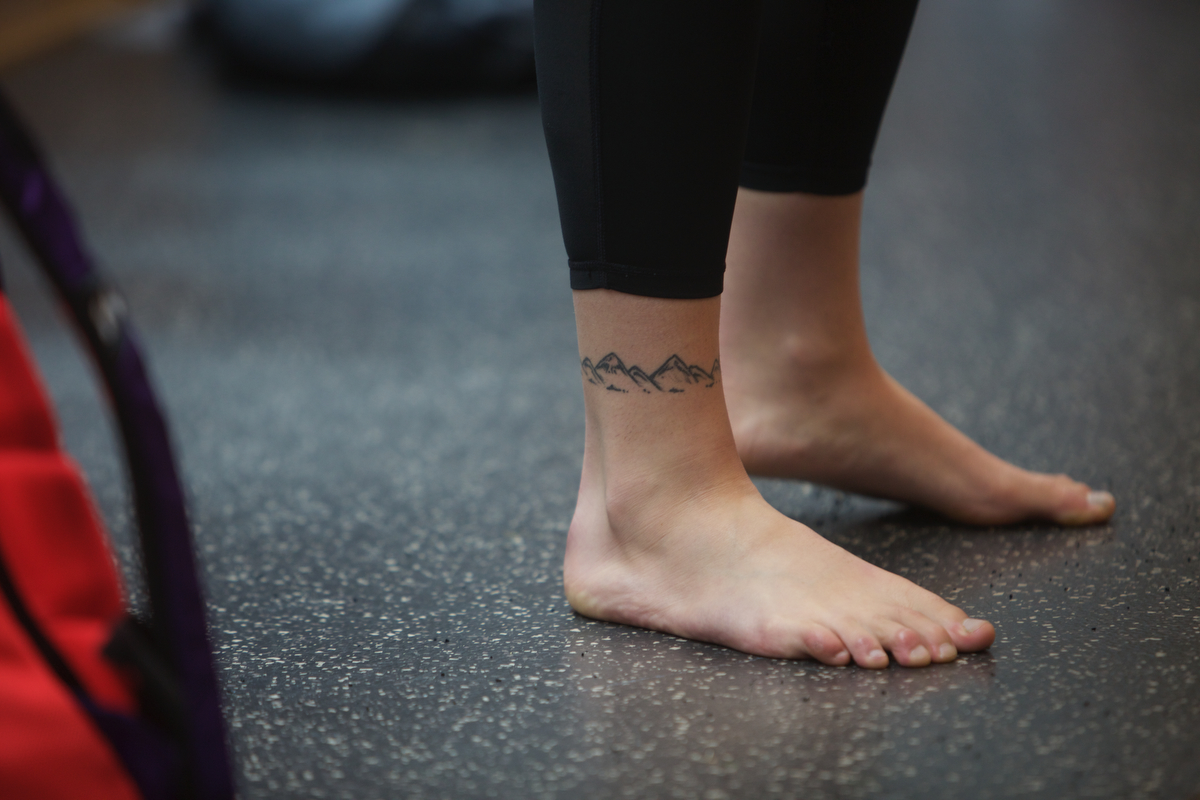 Kelly Roger's ankle tattoo juxtaposed with one on her shoulder, reflect the highs and lows of existence.